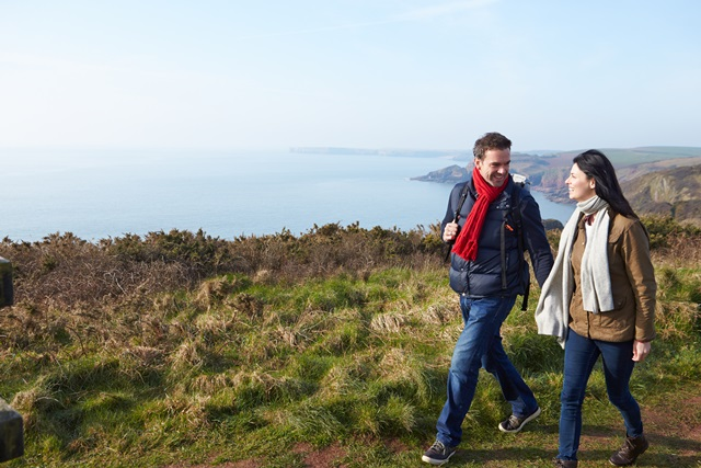 Couple Walking Along Coastal Path
